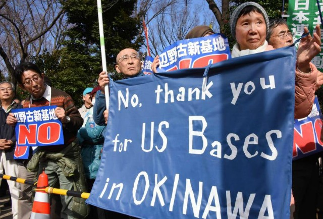 Protesters in front of Japan's Parliament on Sunday. (Photo: AFP-JIJI)