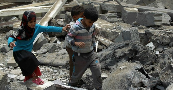 Yemeni children walk amid the rubble of a house in Yemen's Huthi rebel-held capital Sanaa on August 11, 2016, after it was reportedly hit by a Saudi-led coalition air strike. (Photo: AFP/Mohammed Huwais)