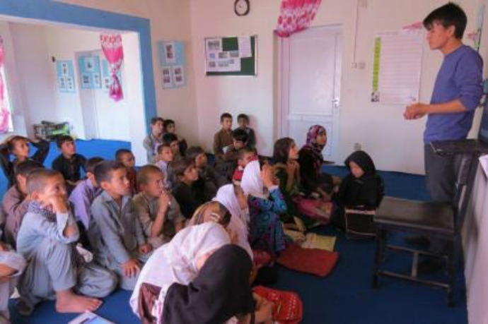 Ali teaching at Street Kids' School. (Photo courtesy of Brian Terrell)