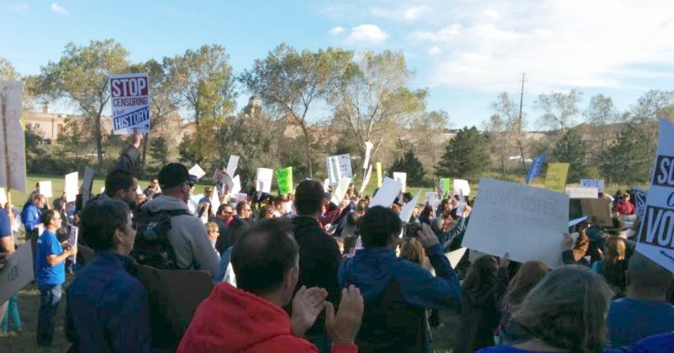 While hundreds squeezed into the school board meeting room, others gathered with signs outside. (Photo: @Ed4Colorado/Twitter)
