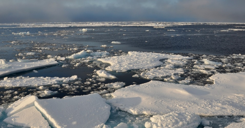 Blue sky begins to break through the clouds over Arctic Ocean ice Sept. 9, 2009. (Photo: Patrick Kelley/U.S. Coast Guard/public domain)