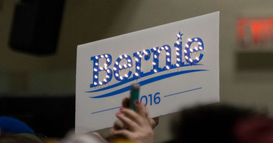 A Bernie Sanders supporter holds a sign during a January 26, 2016 rally. (Photo: Ian Buck/flickr/cc)