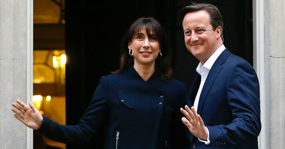 Britain's Prime Minister David Cameron and his wife Samantha return to 10 Downing Street in London, May 8, 2015. (Photo: Kirsty Wigglesworth/AP)