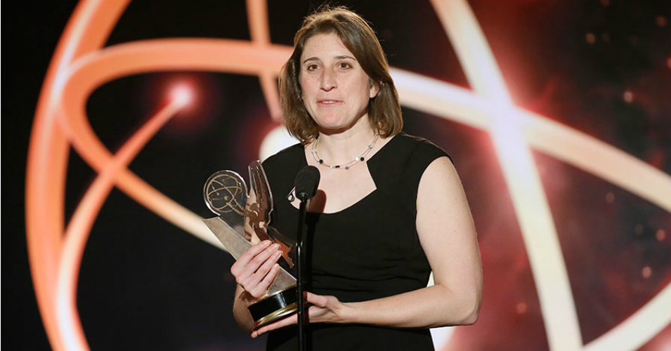 Deia Schlosberg accepting an Emmy for the 2010 documentary series Gasland, which exposed the devastating impacts of the fracking industry on communities in the U.S. (Photo: Danny Moloshok/AP)
