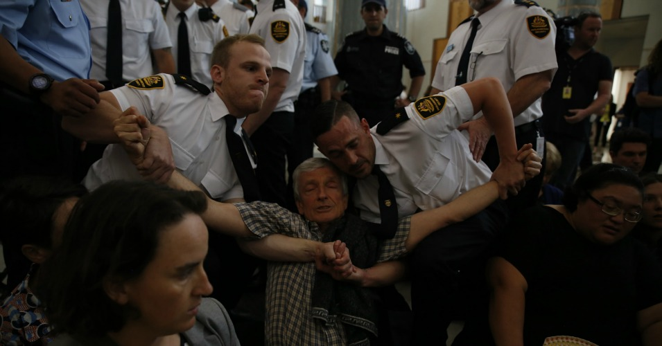 Another climate protester being forcibly removed by security at the Parliament House.  (Photo: 350 .org/flickr/cc)