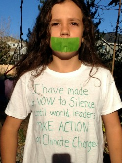 "His T-shirt explains, ""I am taking a vow of silence until world leaders take action on climate change."""