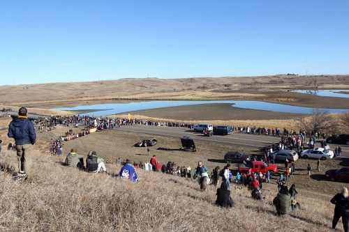 The interfaith witness formed a huge Niobrara Circle of Life just south of the backwater bridge where on the other side law enforcement officers kept watch. Opponents of the Dakota Access Pipeline have held the bridge since law enforcement on Oct. 24 cleared a newly set up protest camp on private land; land that some say belongs to the Sioux Nation.