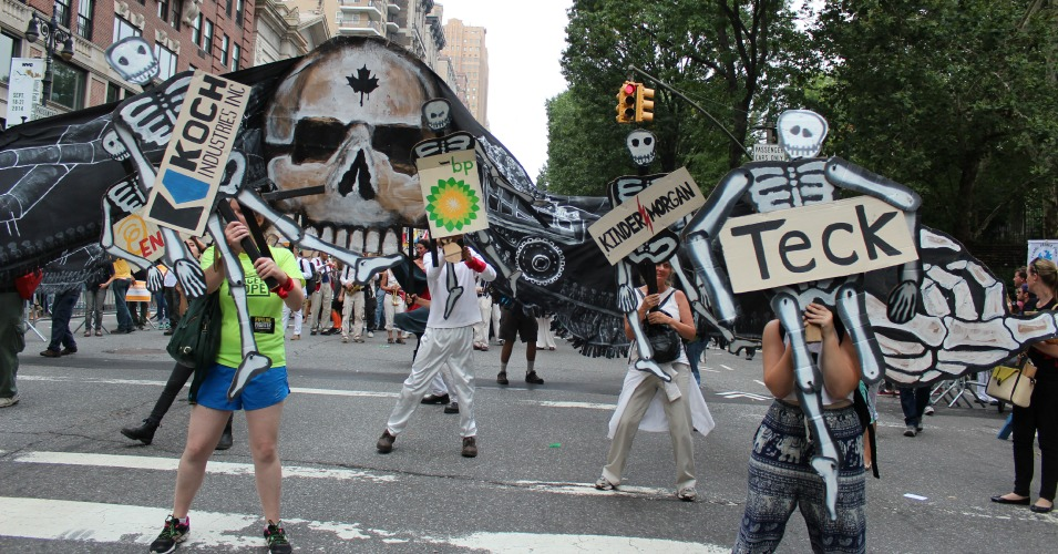 Activists use signs and puppets to protest big gas and oil companies at the People's Climate March on September 21, 2014. (Common Dreams: CC BY-SA 3.0 US)