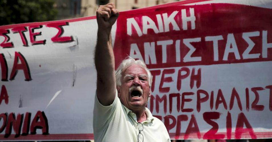 A protester shouts slogans during a rally organised by the country's biggest public sector union, marking a 24-hour strike in Athens on Wednesday. (Photo: Reuters/Alkis Konstantinidis)