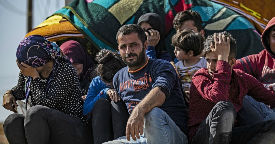Tens of Thousands Flee Syrian Border Towns as Turkey Bombards Country