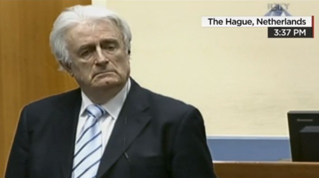 Radovan Karadzic stands as the tribunal's verdict is read.  (Photo: CNN video screengrab)