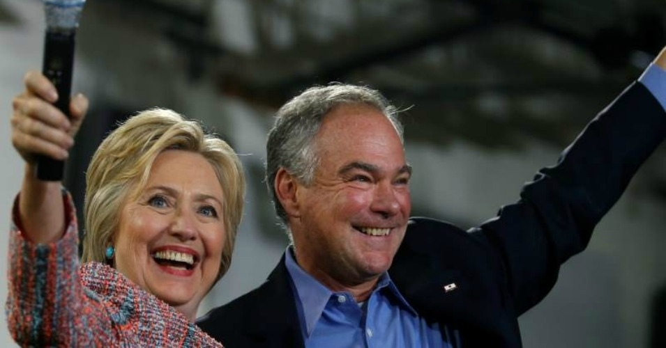 Democratic presidential candidate Hillary Clinton and U.S. Senator Tim Kaine (D-VA) wave to the crowd during a campaign rally at Ernst Community Cultural Center in Annandale, Virginia, U.S., on July 14, 2016. (Photo: Reuters/Carlos Barria)