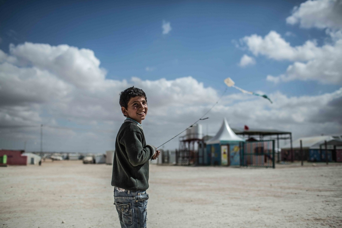 """Every time I fly my kite, I feel free,"" says this 13-year-old from Daraa in Syria at the Zaatari refugee camp in Jordan. (Photo: Oxfam International/flickr/cc)"
