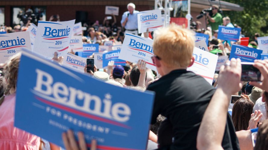 Supporters hold sign as Bernie Sanders speaks at the Iowa State Fair in August.  (Photo: Phil Roeder/flickr/cc)