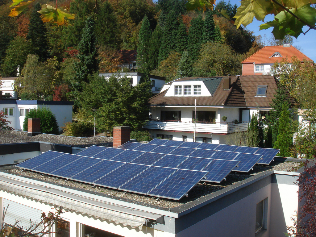 Solar panels sit atop a flat roof in Austria.  (Photo:  Steamtalks Steamtalks/flickr/cc)
