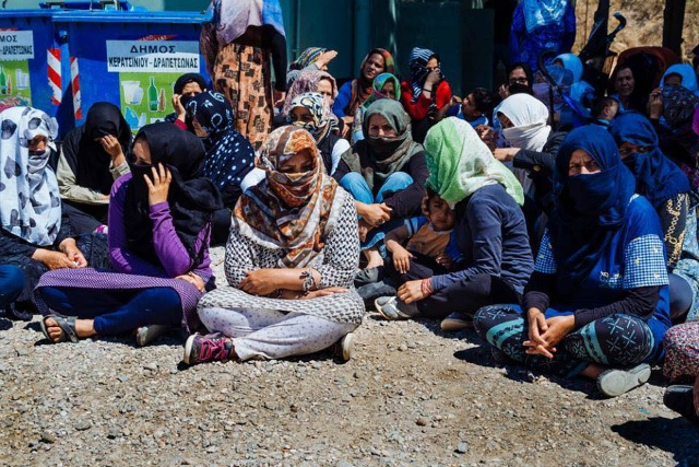 Women at the Schisto refugee camp during the second day of the residents' hunger strike protesting dire conditions. (Photo: Yannis Androulidakis and Agelos Kalodoukas, via AnalyzeGreece)