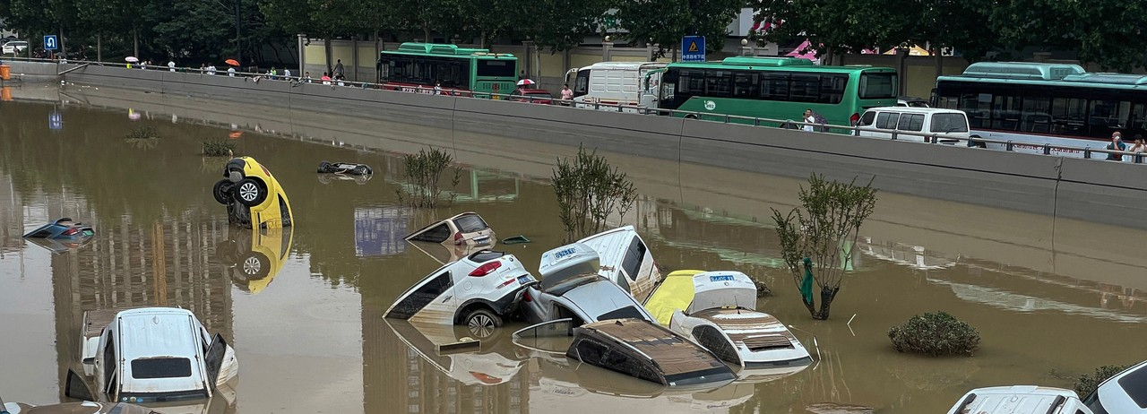 Cars sit in floodwaters after heavy rains hit the city of Zhengzhou in China's central Henan province on July 21, 2021. (Photo: STR/AFP via Getty Images)