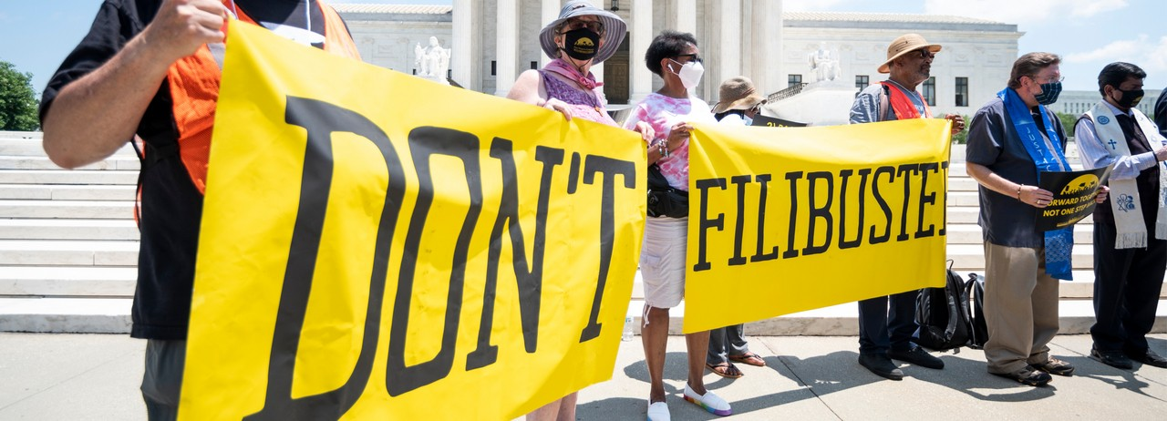 """Participants hold """"Don't Filibuster"""" banners during the Poor People's Campaign news conference in front of the U.S. Supreme Court on July 12, 2021, to announce a season of nonviolent direct action. (Photo: Bill Clark/CQ-Roll Call, Inc via Getty Images)"""