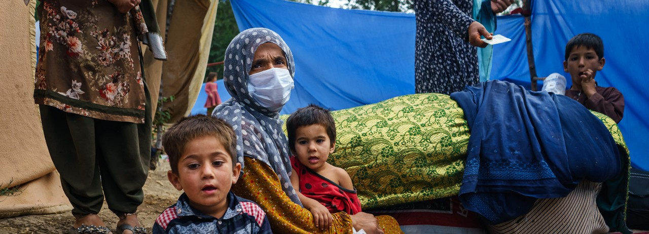 Afghans flee fighting between the Taliban and Afghan security forces