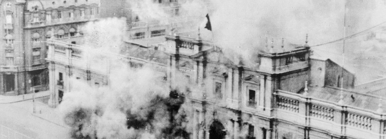 La Moneda, Chile's presidential palace in Santiago, is bombed by the nation's armed forces on September 11, 1973. Salvador Allende, the country's democratically elected socialist president, died during the U.S.-backed coup that brought to power Augusto Pinochet, who imposed neoliberalism through military dictatorship. (Photo: Bettmann via Getty Images)