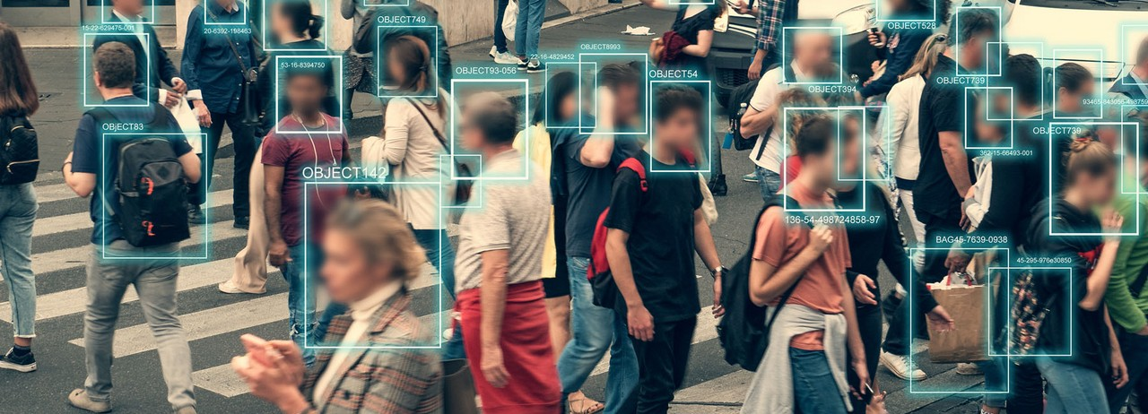 People walking with faces covered in AI data