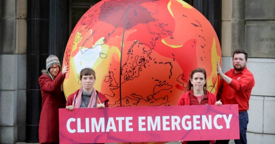 Activists inflated a huge warming earth globe outside Scottish government headquarters at St Andrew's House in Edinburgh in 2017 to highlight the emergency of climate change.  (Photo: Friends of the Earth Scotland/flickr/cc)