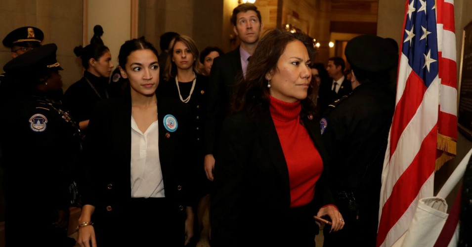 Reps. Alexandria Ocasio-Cortez (D-N.Y.) and Veronica Escobar (D-Texas) accompany other freshmen House Democrats into Senate Majority Leader Mitch McConnell's (R-Ky.) office. (Photo: Yuri Gripas/Reuters)