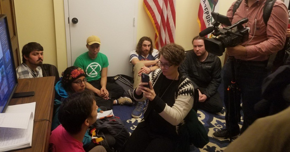 Young climate action advocates began a hunger strike on Monday, occupying House Speaker Nancy Pelosi's office and demanding a meeting with her. (Photo: @XRebelDC)