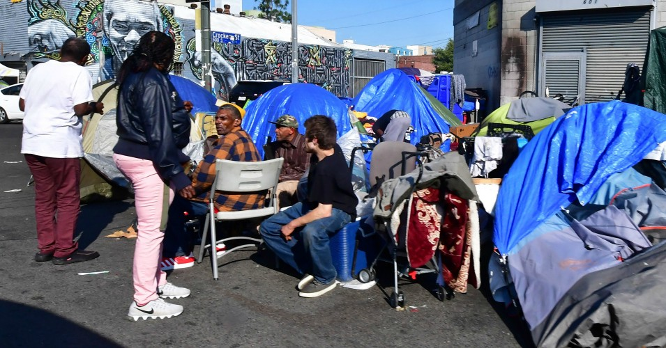 Homeless residents gather outside their tents on a sidewalk in Los Angeles, California on January 8, 2020. - California Governor Gavin Newsom said his state budget will include more than $1 billion directed towards homelessness, in response to a growing crisis on the streets on California's major cities. (Photo:  Frederic J. Brown/AFP via Getty Images)
