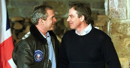 George W. Bush and Tony Blair shake hands at a meeting near Camp Davis in February 2001. (Photo: AFP/Getty)