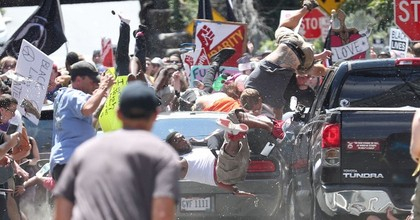 A vehicle plows into a group of protesters marching in downtown Charlottesville on Saturday, killing at least one person and injuring many others .(Photo: Ryan M. Kelly/The Daily Progress)