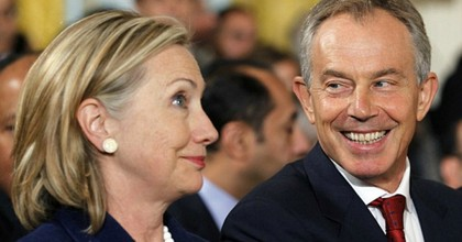 Former U.S. Secretary of State Hillary Clinton shares a laugh with former British Prime Minister Tony Blair, who is under investigation for his role in driving the conflict in Iraq. (Photo: Reuters)