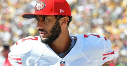 """Colin Kaepernick said he would not stand for the national anthem """"to show pride in a flag for a country that oppresses black people and people of color."""" (Photo: Brook Ward/flickr/cc)"""