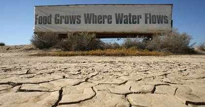 """A sign on the side of a truck in Buttonwillow, California reads, """"Food grows where water flows."""" (Photo: Getty)"""