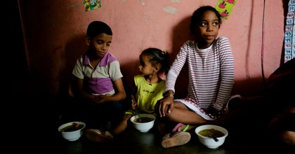 Children of Barrio Unión Sector Las Casitas eat soup prepared and donated by Alto Restaurant in the house of a neighbor on April 12, 2019 in Caracas, Venezuela. (Photo: Eva Marie Uzcategui/Getty Images)