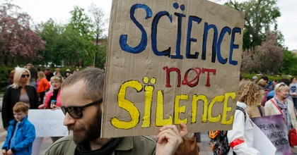 A man holds a placard reading 'Science not silence' during a 'March For Science' in Kiev, Ukraine, on May 4, 2019. Hundreds of Ukrainian scientists and supporters took part in the march in support of science and the liberty of research, during their march in center of the Ukrainian capital. (Photo: STR/NurPhoto via Getty Images)