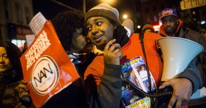 Erica Garner, daughter of Eric Garner, leads a march of people protesting the Staten Island, New York grand jury's decision not to indict a police officer involved in the chokehold death of Eric Garner in July, on December 11, 2014. (Photo: Andrew Burton/Getty Images)