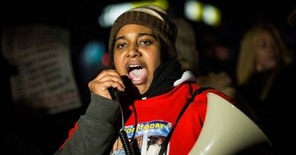 Erica Garner, daughter of Eric Garner, leads a march of people protesting the Staten Island, New York grand jury's decision not to indict a police officer involved in the chokehold death of Eric Garner in July, on December 11, 2014 in the Staten Island Neighborhood of New York City. (Photo: Andrew Burton/Getty Images)