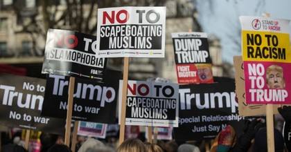 Demonstrators holding placards protest outside the U.S. Embassy against U.S. President Donald Trump on February 4, 2017 in London, England. (Photo: Jack Taylor/Getty Images)