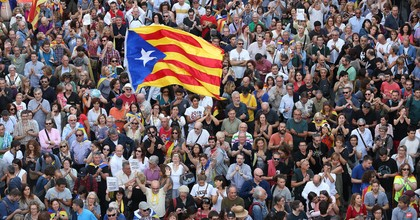 People hold up Catalan independence flags at a Catalan independence rally to demand the release of imprisoned Catalan leaders Jordi Sanchez and Jordi Cuixart on October 21, 2017 in Barcelona, Spain. The Spanish government announced measures today it will implement in triggering Article 155, which would lead to the imposition of direct rule by Spanish authorities in Catalonia and at least temporarily suspend the region's autonomy. The government also plans to hold Catalan regional elections in January. The moves come after Catalan regional President Carles Puigdemont let a Thursday deadline today pass and threatened to go forward with Catalan independence. (Photo: Sean Gallup/Getty Images)