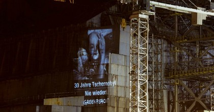 The human face of Chernobyl: Greenpeace project portraits of survivors onto damaged reactor. (Photo: Daniel Mueller/ Greenpeace)