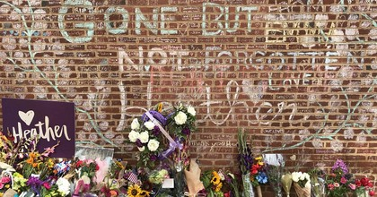 Mourners gathered Sunday at memorial dedicated to Heather Heyer, who was killed last year when a participant in the white supremacist demonstrations in Charlottesville, Virginia rammed a vehicle into a crowd of counter-protesters. (Photo: Tess Owen/Twitter)