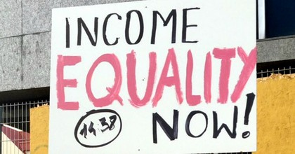 A sign held up during Monday's rally for wage parity in Reykjavík, Iceland. (Photo: Filmmor/Twitter)