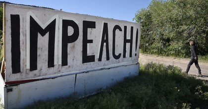 A large handmade sign erected along a highway in Velarde, New Mexico, urges that President Donald Trump be impeached. (Photo: Robert Alexander/Getty Images)