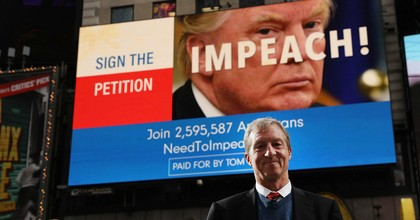 Philanthropist Tom Steyer stands in front of one of the billboards he has funded in Times Square calling for the impeachment of President Donald Trump on November 20, 2017 in New York City. Steyer, an American hedge fund manager, environmentalist, progressive activist, and fundraiser announced Tuesday he is running for the 2020 Democratic presidential nomination—the 25th person to officially do so. (Photo: Spencer Platt/Getty Images)