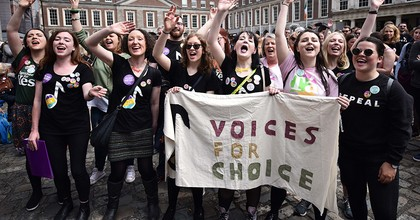 DUBLIN, IRELAND - MAY 26: Yes vote supporters celebrate as the results in the Irish referendum on the 8th amendment concerning the country's abortion laws takes place at Dublin Castle on May 26, 2018 in Dublin, Ireland. Savita Halappanavar who became the symbol of the Yes campaign to repeal the 8th amendment died aged 32 due to complications following a septic miscarriage in Galway, 2012. Voters in Ireland went to the polls yesterday to decide whether to abolish or keep the 8th amendment which makes it illegal for a woman to have an abortion in the country unless in certain circumstances where her life is at risk. Exit polls indicated that the Yes vote has won by a landslide majority and the No campaign has conceded defeat. (Photo by Charles McQuillan/Getty Images)