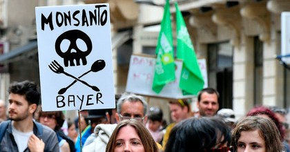 Demonstrators walk with placards during a march for agroecology and civil resistance against U.S. seed and pesticide maker Monsanto on May 20, 2017 in Bordeaux, southwestern France. (Photo: Georges Gobet/AFP/Getty Images)
