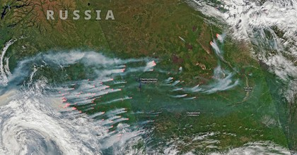 Several wildfires between about 57°N and 70°N in Krasnoyarsk Krai and Sakha Republic, Russia are captured by satellite on July 21, 2019. (Photo: Aqua and Terra MODIS data through NASA Worldview, processed by Pierre Markuse/Flickr/cc)