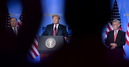 President Donald Trump listens in between U.S. Secretary of State Mike Pompeo and national security adviser John Bolton during a news conference at the 2018 NATO Summit at NATO headquarters on July 12, 2018 in Brussels, Belgium. (Photo: Jasper Juinen/Getty Images)