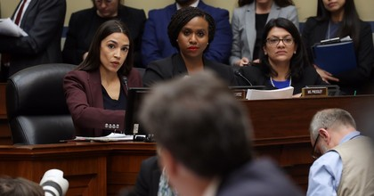 Rep. Alexandria Ocasio-Cortez (D-N.Y.), Rep. Ayanna Pressley (D-Mass.) and Rep. Rashida Tlaib (D-Mich.) listen as Michael Cohen, former attorney and fixer for President Donald Trump, testifies before the House Oversight Committee on Capitol Hill February 27, 2019. (Photo: Chip Somodevilla, Getty Images)